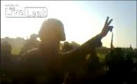 Солдаты сирийской армии давят тела мятежников танками