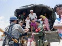 Мусульмане спасаются от буддийских боевиков в монастыре