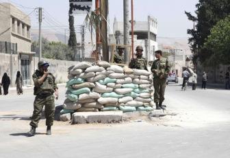Выборы Асада в военной Сирии