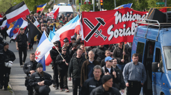 Неонацисты, фашисты и бывшие террористы: кто приехал на форум в Санкт-Петербург