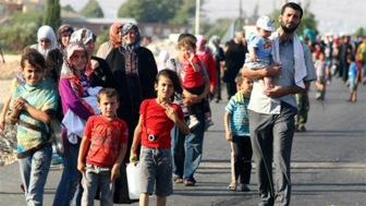 Сирийских беженцев принимают на Западе