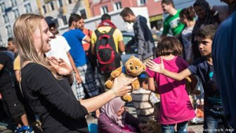 Ангела Меркель: беженцы - это шанс для Германии