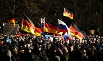НАТО: Путин использует беженцев и экстремистов против Меркель